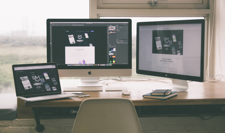 photo of website design on a laptop and desktop